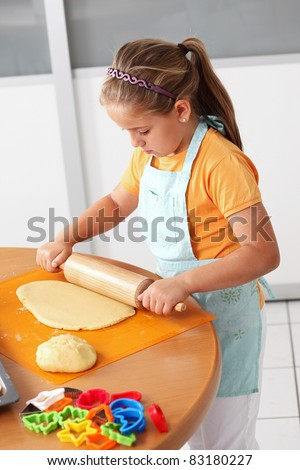Cute girl baking cookies for Christmas - stock photo