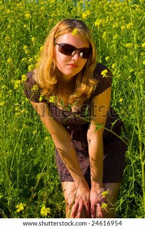 Cute girl basking in the sun - stock photo