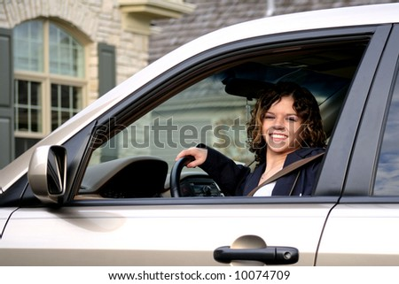Cute girl behind the wheel of a car - stock photo
