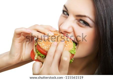 cute girl biting hamburger on white background - stock photo