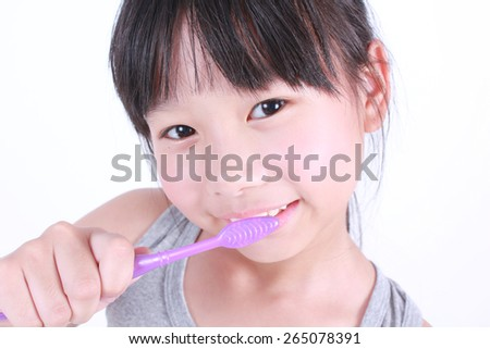 Cute girl brushing her teeth - stock photo
