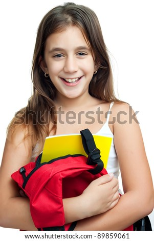 Cute girl carrying her school backpack with textbooks isolated on a white background - stock photo