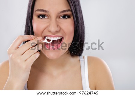 cute girl cleaning her teeth - stock photo