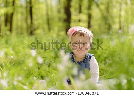 cute girl closed her eyes tight - stock photo