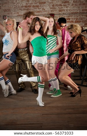 Cute girl dancing with tube sox and high heels - stock photo