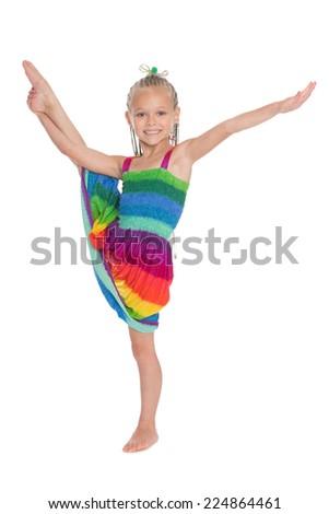 Cute girl doing exercise vertical split. Girl is six years old. - stock photo