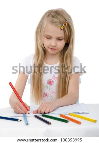 Cute girl draw with colorful pencils. isolated on white background - stock photo