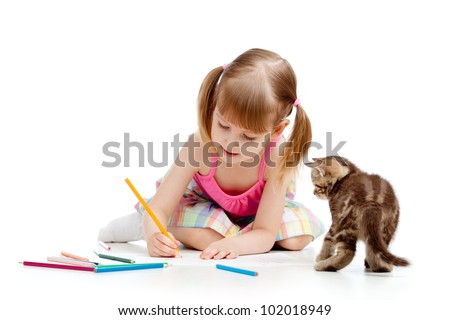Cute girl drawing a picture with color pencils. Kitten looking at child.