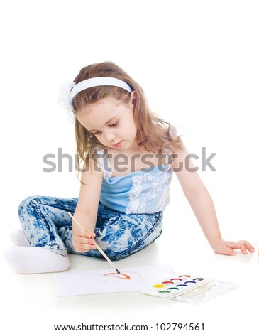 Cute girl drawling with watercolor paint and brush - stock photo