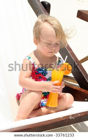 Cute girl drinking orange juice - stock photo