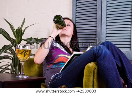 Cute Girl Drinking while Reading a Book - stock photo