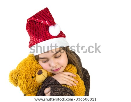 Cute girl embracing bear toy. - stock photo