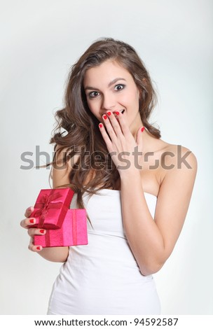 Cute girl happy with a small box - stock photo