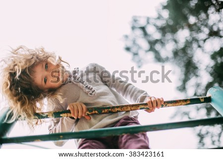 cute girl having fun at the playground - stock photo