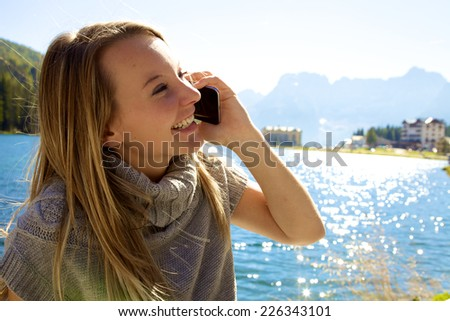 Cute girl having fun on the phone