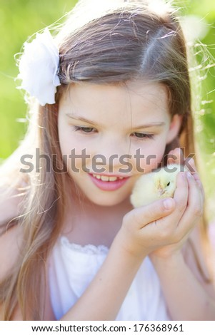 cute girl hold little chicken - stock photo