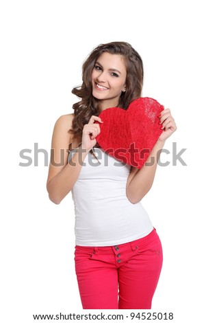 Cute girl holding a big heart - stock photo
