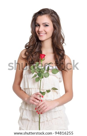 Cute girl holding a flower - stock photo