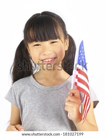 Cute girl holding an American Flag  - stock photo