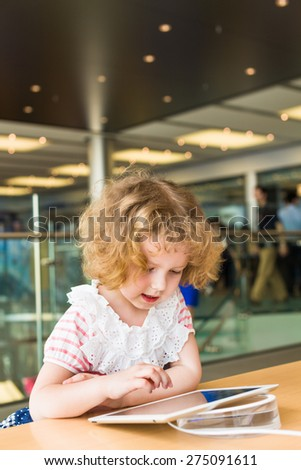 Cute girl holding an digital tablet - stock photo