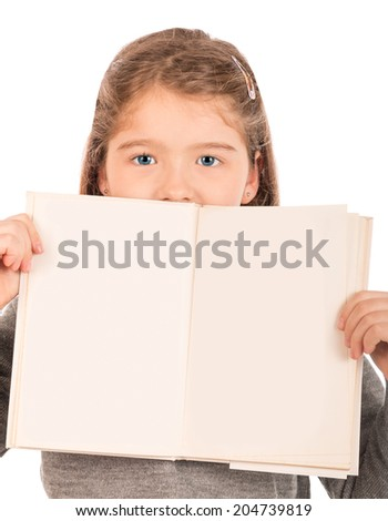 Cute girl holding an open blanked book. Isolated on white. - stock photo