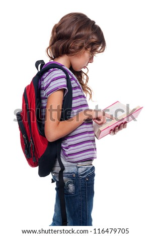 cute girl holding book and reading. studio shot over white background - stock photo