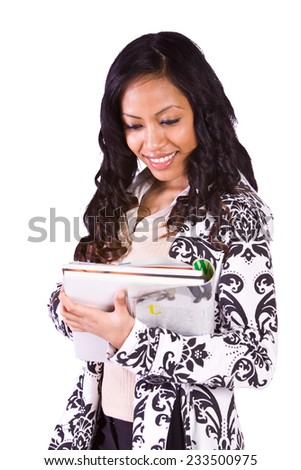 Cute Girl Holding Books and Magazine - Isolated Background - stock photo