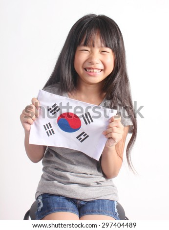Cute girl holding Korea Flag - stock photo