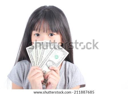 Cute girl holding money  - stock photo