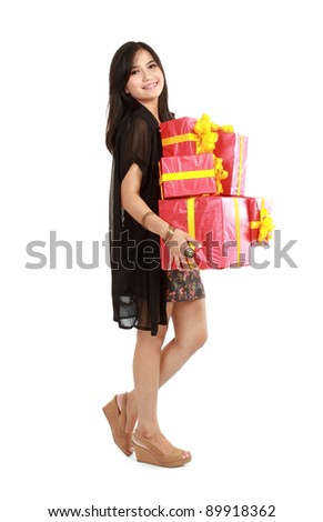 Cute girl holding the red box present over white background - stock photo