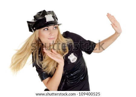 Cute girl in a uniform of  police officer on a white background - stock photo