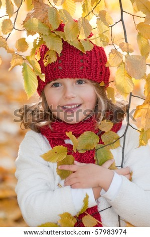 Cute girl in autumn park portrait - stock photo