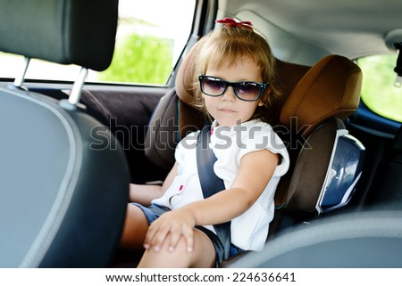 cute girl in car seat - stock photo