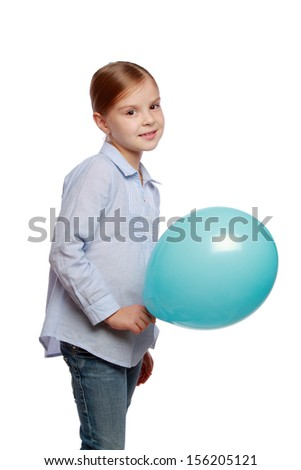 Cute girl in casual clothes holding blue balloon isolated on white