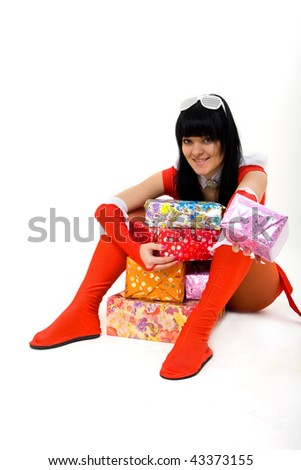 cute girl in christmas costume with presents