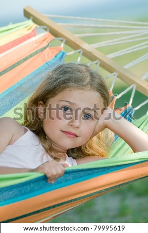 Cute girl in colorful hammock - stock photo