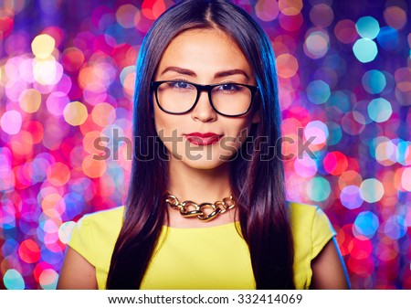 Cute girl in eyeglasses looking at camera - stock photo