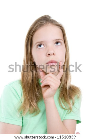 Cute girl in green shirt looks lost in thoughts  Isolation on white. - stock photo
