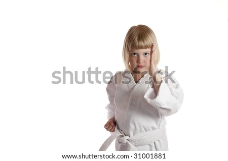Cute girl in karate dress with guard up on white background - stock photo