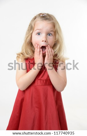cute girl in red dress with a shocked expression