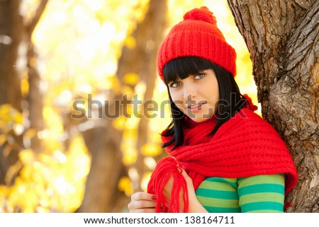 cute girl in red scarf and hat