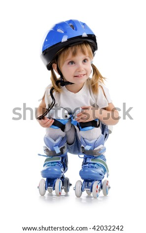 Cute girl in roller skates on a white background - stock photo