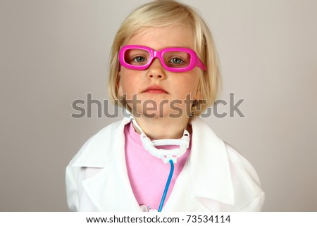 cute girl in spectacles and stethoscope - stock photo