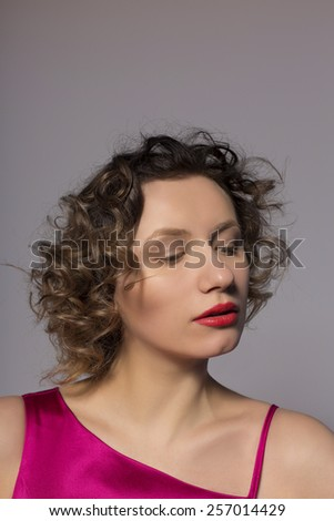 cute girl in studio looking down - stock photo