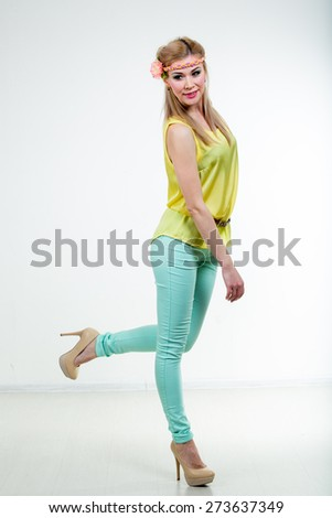 cute girl in summer beautiful clothes studio