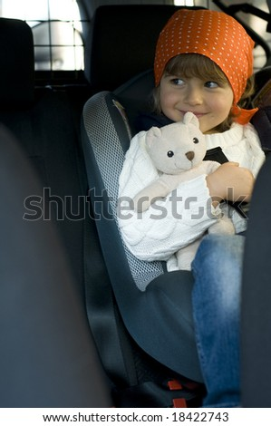 Cute girl in the car - stock photo