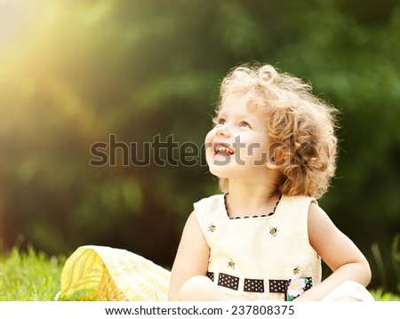 Cute girl in the park - stock photo