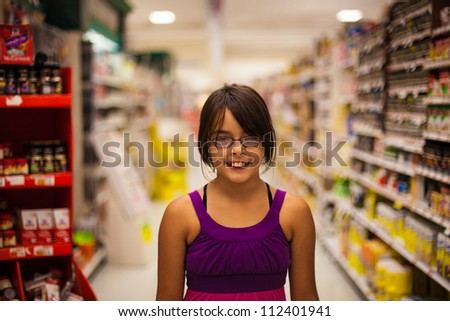 Cute girl in the supermarket - stock photo