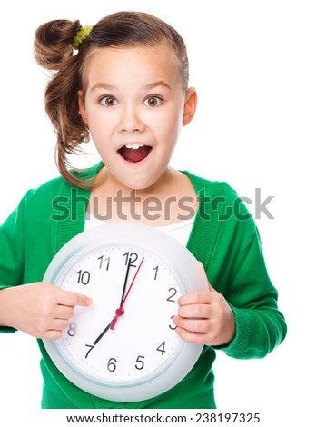 Cute girl is holding big clock and showing hush gesture, isolated over white - stock photo