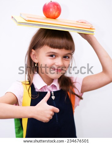 Cute girl is holding book - school concept - stock photo